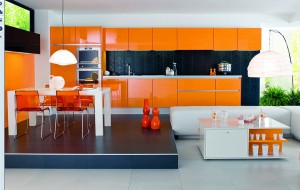 ORANGE is such a bold color and makes this kitchen as a retro place to cook and dine.